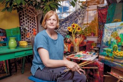 Painter Carol Stewart in her studio at Milo Arts Center in Columbu