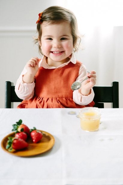 Bianca, just over 1½ years old, enjoys her applesauce and strawberries.