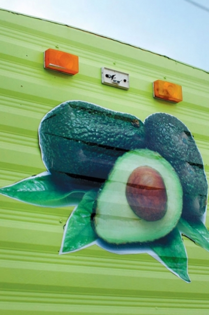 Holy Guacamole's inside-of-an-avocado-colored food cart