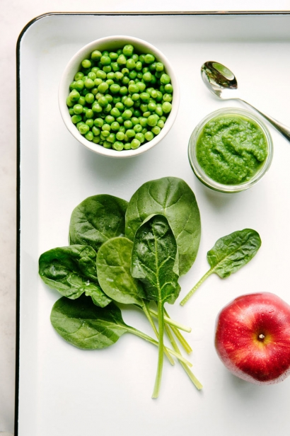All the fixings for a spinach, pea and apple puree.
