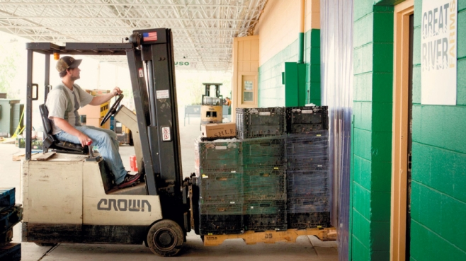 Adam Utley loading in pallets of food for distribution.